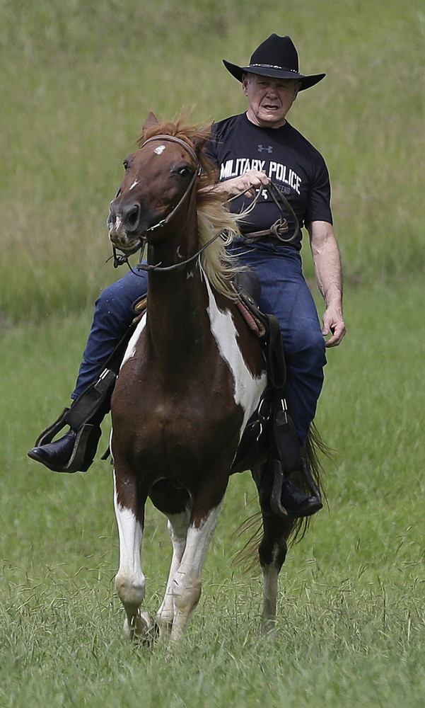 Former Alabama Chief Justice and U.S. Senate candidate Roy Moore, rides in  on a horse