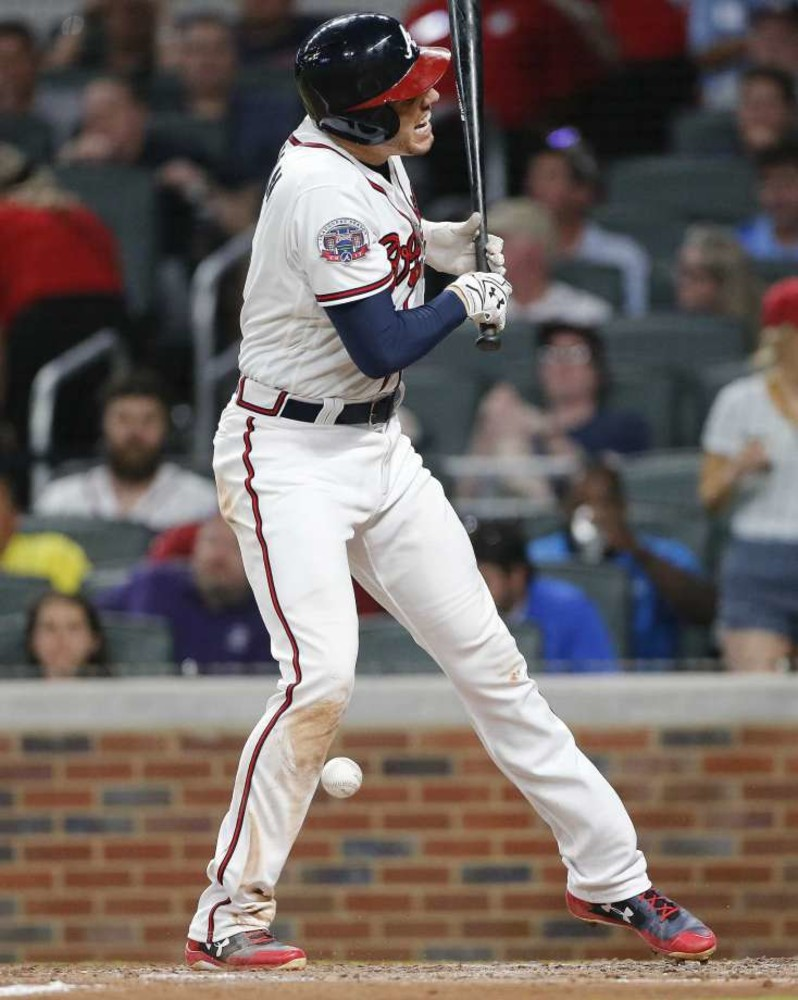 Atlanta Braves' Freddie Freeman reacts after being hit by a pitch during  the fifth inning